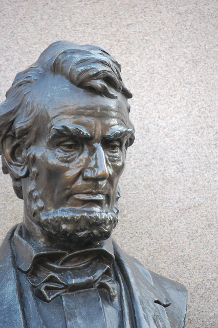 Bronze bust of Lincoln that reveals the heavy toll the nation's suffering and the war had upon him