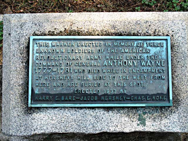 This marker erected in memory of three Unknown Soldiers of the American Revolutionary Army while under the command of General Anthony Wayne 1777-1781 who died while in encampment at Hersheys Hill side to the west from here and are buried at this spot.  Erected 1937 by Harry E. Bare, Jacob Hershey & Chas. E. Hoke